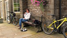 Helen stops for coffee and a rest after all that cycling!