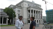 Tom Service with the BBC's Balkans correspondent Damian McGuinness outside the Latvian National Opera