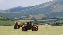 Gathering hay at Mynachdy Hill farm near Machynlleth, West Wales; Courtesy of Gerry Hunt