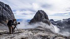 Mt.Kinabalu. Cameraman Richard Kirby captures the building clouds on Borneo's highest peak