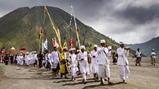 Tenggerese people begin the Kasada festival at the base of Mt. Bromo, an active volcano