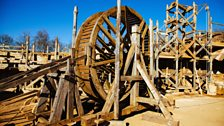 One of Guedelon's wooden treadwheels, with wooden scaffolding behind