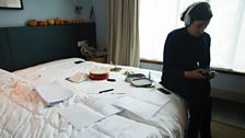 Anna recording percussion instruments in her hotel room