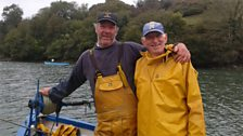 Timmy Heard and Dave Kenderdine aboard their oyster punt at Tolverne.