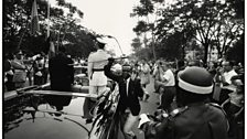 Leopoldville, [Young man steals the sword of King Baudouin I, during procession with newly appointed President Kasavubu]