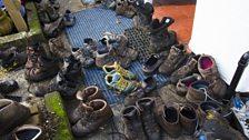Abandoned boots outside the pub