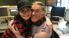 Lulu gives Sir Terry a hug