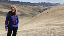 Kate stands in the 'Three Beauties' mountain range of the Gobi desert