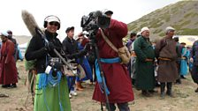 Wearing tranditional dress while ilming at the Yak festival