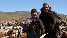 Kate and nomadic herder Ordnor holding baby cashmere goats