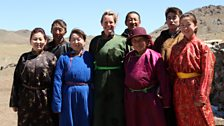 Kate with the family of Nomads she lived with in the Gobi Desert, Omnogovi Province, Mongolia