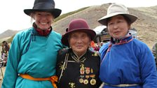 Kate, Chimed and Ordnor in traditional dress at a Yak Festival