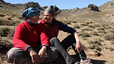 Kate and nomadic herder Suren sit and share a laugh in the Gobi Desert