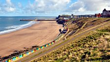 Whitby beach huts in April sun