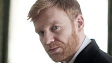 Brian Gleeson plays Powell Imrie, Don's right hand man