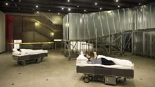 Installation view: Two Roaming Beds (Grey) and Decision Corridors
