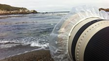 Long lens with a shower-cap on the end to protect it from water, Point Lobos, California, May 2015