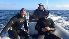 Presenter Steve Backshall and cameraman Simon Enderby in their wetsuits ready to dive in Monterey Bay, California