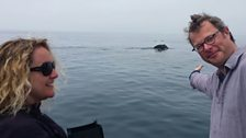 Hugh Fearnley-Whittingstall and Producer Joanne Stevens admire a passing humpback whale in Monterey Bay, California