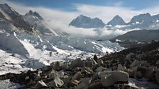 The highest mountains on earth give birth to great rivers of ice – glaciers – which slide downhill under the pull of gravity