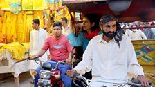 Sona on a rickshaw in Pakistan