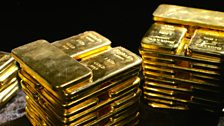 Stacks of gold bars. Each weighs 1 kilogram and is composed of 99.99% pure gold