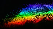 The visible spectrum captured by water droplets in mid-air