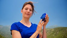 Helen holds a lump of blue lapis lazuli in the hills of Southern California