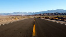 The road running along the bottom of Death Valley, California