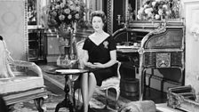 The Queen photographed for her 1960 Broadcast with her corgi, Sugar, by her side!