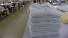 The end of the production line - completed shirts at C&H Garments