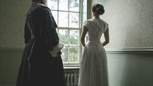Charlotte Bronte, played by Sophie Trott looks out the window