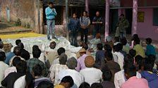 Villagers in Arniya Daoud, India listen to a community-led Total Sanitation Facilitator
