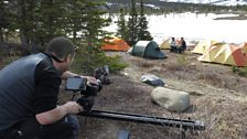 Cameraman Johnny Rogers films Liz Bonnin with caribou scientist Mike Suitor at Sheep Creek base camp