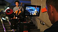 Sheku Kanneh-Mason is filmed in the foyer of the Barbican Centre by cameraman Paul for the TV broadcast