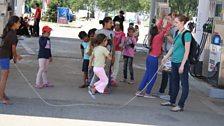NGO volunteers and refugee children at the EKO petrol station