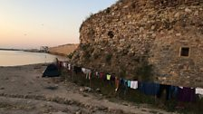 Refugee clothes drying alongside Chios' ancient fortress