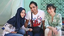 Ali and Wissam, brother and sister from Syria with Maria at the remains of their temporary home