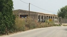 The former Softex toilet roll factory on the outskirts of Thessaloniki, now a government run refugee camp