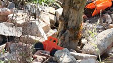 Toys and life jackets that were found washed up on beaches in Greece are strewn around the garden.