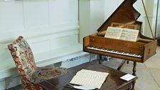 Handel's harpsichord as part of Handel at Boughton, with a portrait of G.F. Handel.