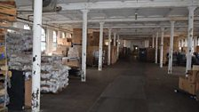 Inside the old Singer factory, now a warehouse for imported Chinese goods