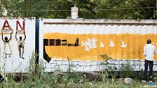 Murals have appeared on walls and shipping containers across the capital, Juba.