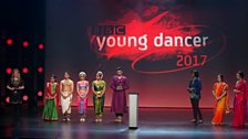 The South Asian Dance finalists and judges with stage presenter Naomi Wilkinson