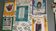 A condolence poster for Nisa's parents signed by her classmates