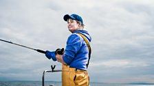 Annie Gilbert, fisherman, on board her boat the Happy Hooker