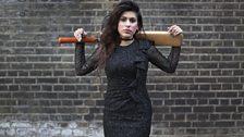 Black dress, blue nails, cricket bat