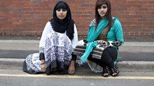 Sisters sitting on kerb