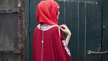 Red hijab, red dress and bling