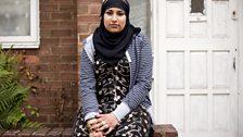 Black hijab, gold dress and bling